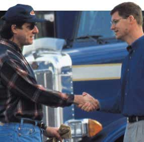 Trucker and a Man Shaking Hands